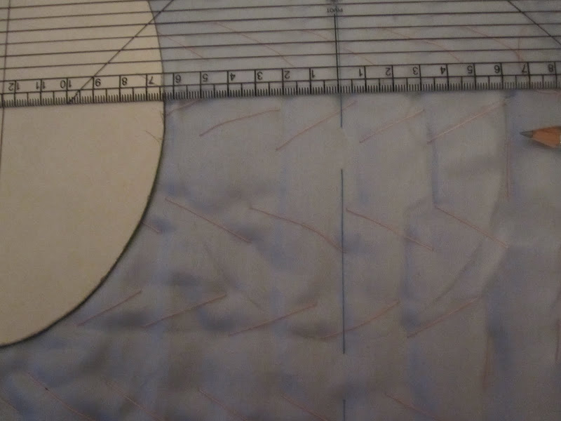 First oval drawn over CF line. Template positioned ready to draw the next oval.