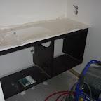 Skab og håndvask på toilettet
