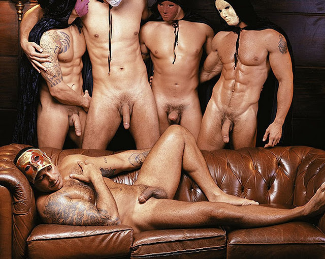 alexandre frota lying back on the couch nude caressing his hairy chest while his nude friends watch him