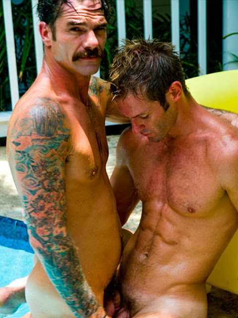 levi poulter and ryan findlay at the edge of the pool nude