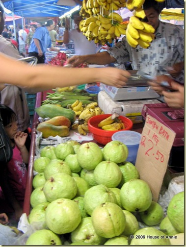 Buying Fruits at the Night Market