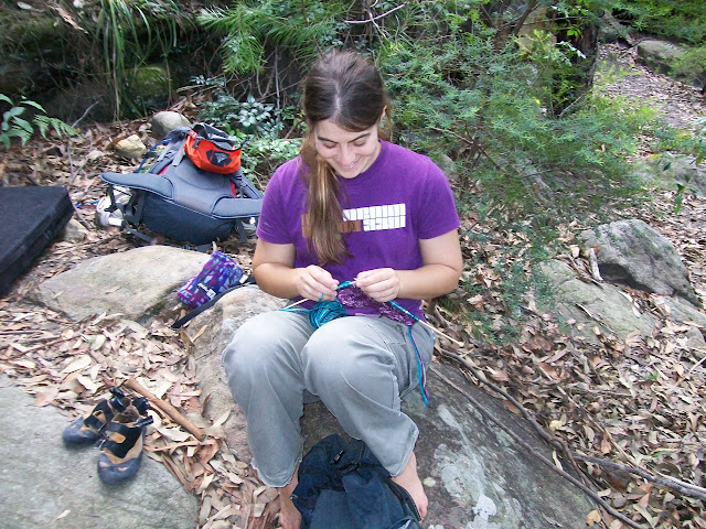 Yael knitting in a forest