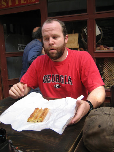 Carey Eating Burek, Its Hot!
