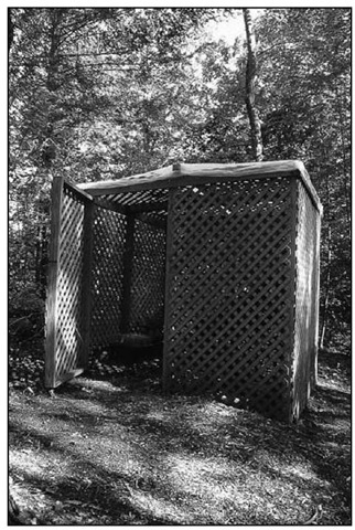 My shade house is an 8-foot (2.4-m) square simply constructed using wood lath and 4-x-4-inch (10-x-10-cm) pressure-treated wood posts.