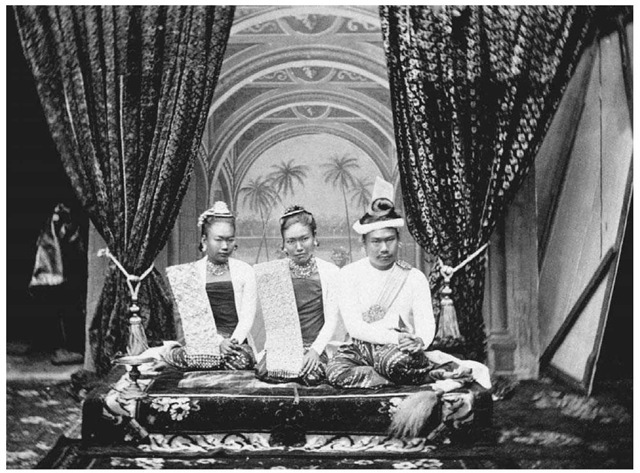 King Thibaw and Queen Supayalat of Burma. The king and queen of Burma are pictured along with the queen's sister at their palace in Mandalay, Burma, in the 1800s. Thibaw reigned from 1878 to 1885, when the British forced him from the throne.