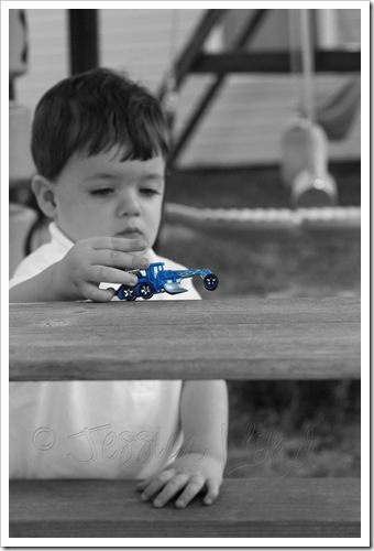 a TUCKER-WITH-CAR copy edited b&w with color