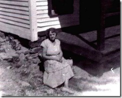 Grandma Milligan sitting in front of house cropped