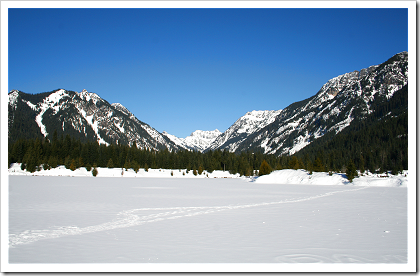 Gold Creek: mountains frame the snowy pond