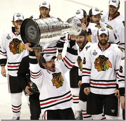 The Chicago Blackhawks' Marian Hossa hoists the Stanley Cup as his teammates look on following a 4-3 overtime victory against the Philadelphia Flyers in Game 6 of the Stanley Cup Finals at the Wachovia Center in Philadelphia, Pennsylvania, on Wednesday, June 9, 2010. (David Maialetti/Philadelphia Inquirer/MCT)