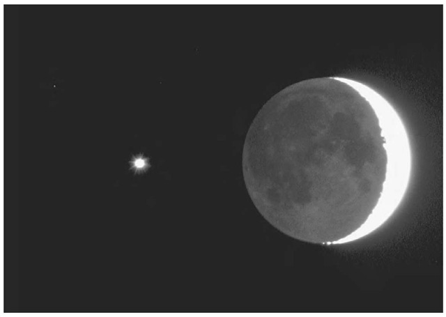 The planet Venus (left) near a crescent moon. Earthshine illuminates the rest of the moon's disk.