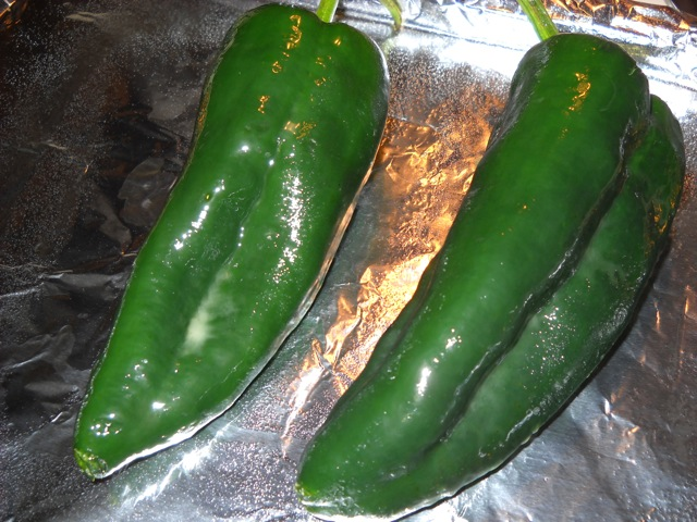 Coat the poblanos in oil to prepare them for roasting.