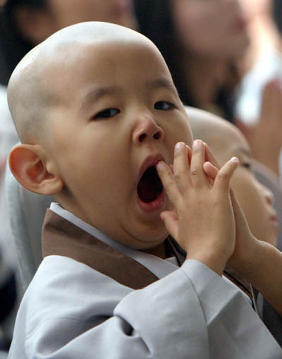 little monk yawning