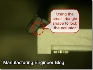 Some of the right angle connector use a small triangle shape to lock the actuator on housing.