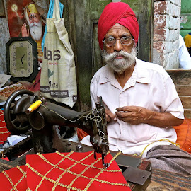 PORTRAIT OF SIKH MAN #12 by Doug Hilson - People Portraits of Men ( piercing eyes, color, street tailor, india, sikh man, portrait )