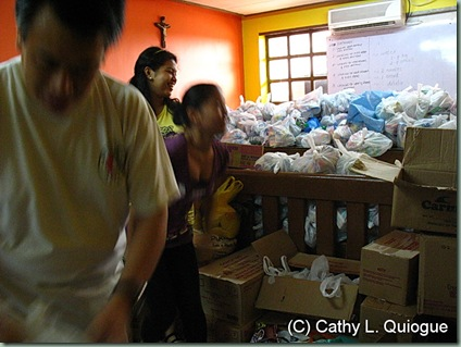I sort and pack food with the young volunteers