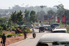 The red dirt seems to tint everything an ochre color in Kampala. And notice the cars driving on the left side. Very cool...