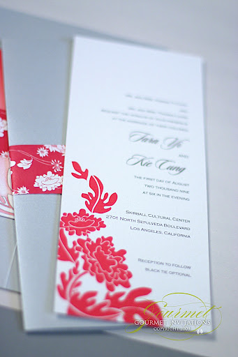 of the wedding invitation was designed with a flowing fuschia peony