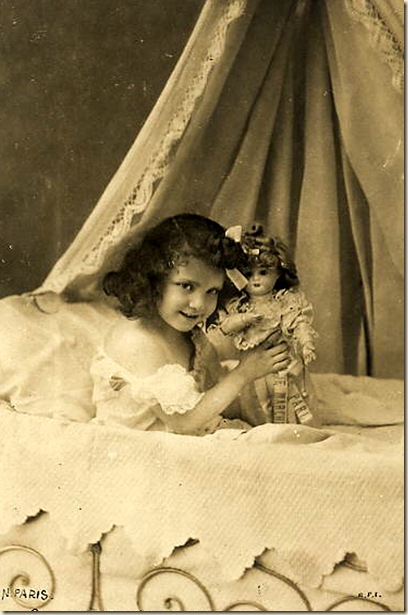 girl on bed with doll