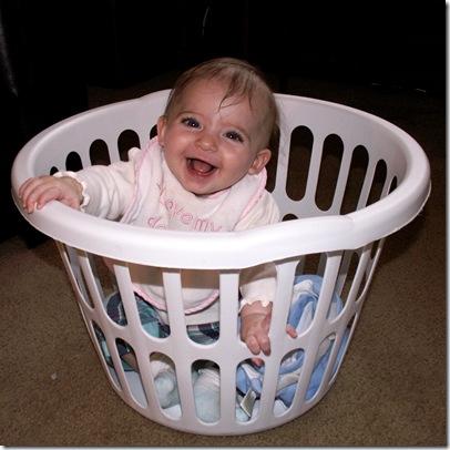 Elaine 24 Weeks inside laundry basket