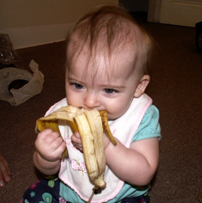Elaine 6 months eating banana