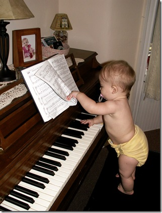 Elaine 8 months playing piano