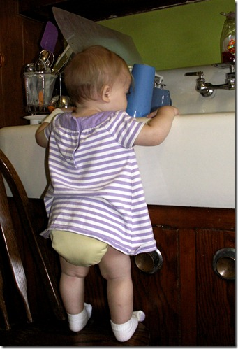 Elaine 10 months washing dishes