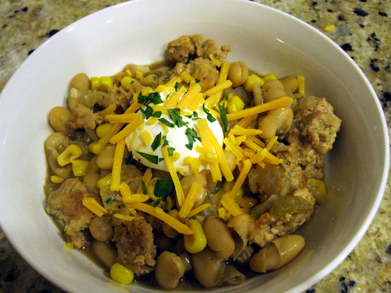 white turkey chili with sour cream and cheddar cheese