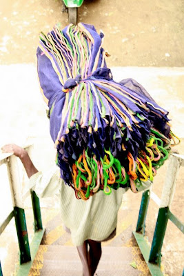 Worker carrying bags at a Sri Lankan tea factory near Hatton