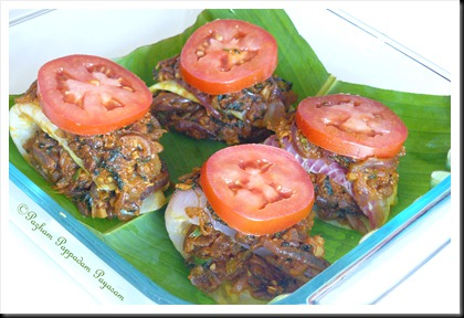 Stuffed, rolled, topped fillets arranged on banana leaf