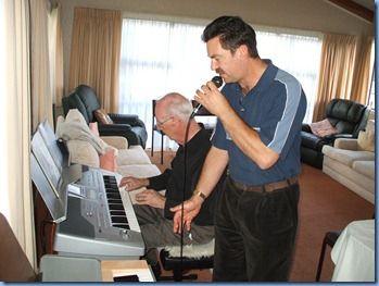 Another rare shot! Peter Littlejohn showing off his vocal skills as Peter Brophy played the Korg