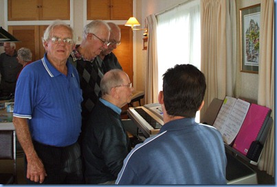 John Beales giving the Korg Pa1X a go watched-on intently by Skip Eade, Peter Jackson, Peter Brophy and Peter Littlejohn