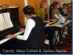 Carole Littlejohn accompanying her students, Mary Cohen on the Tyros 2 and James Hunter on the Korg Pa1X