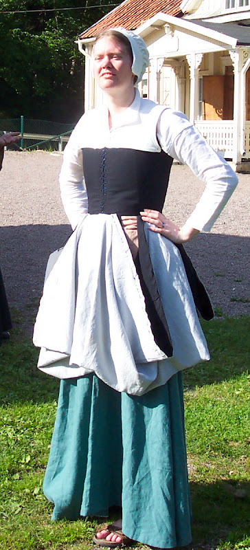 Skirt tucked up from the front