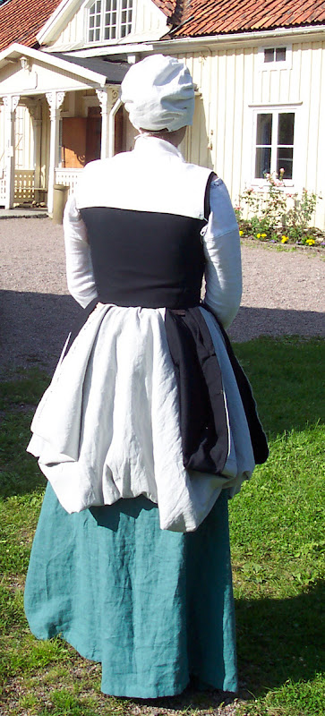 From the back with skirt tucked up