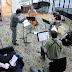 """Italian composer Filippo Perocco leading a quartet of New York musicians in Lorenzo Tomio's """"Giorni smègi e lombidiosi"""""""