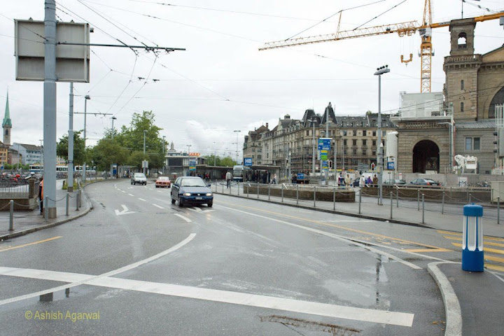 Streets in Zurich have large electric overheads because of the train and tram system