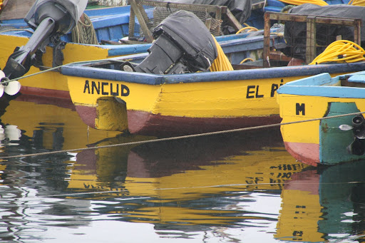 Colorful boats in Ancud, Chile