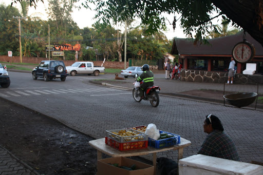Locals shop for their produce early at the market and the truck vendors