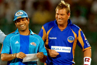 Sachin enjoying a light-moment with Shane Warne during an IPL match
