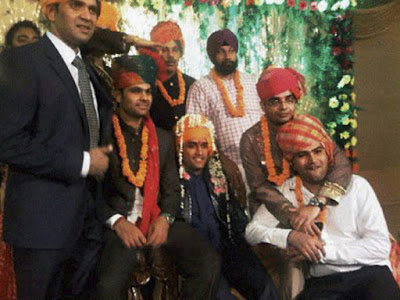 Mahendra Singh Dhoni with his friends at his wedding