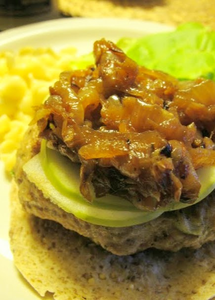 Caramelised onions on sage/onion pork burger with apples and mustard