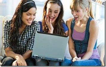 women laughing - looking at laptop