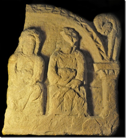 carving of seated mother goddesses holding baskets from the third century in britain