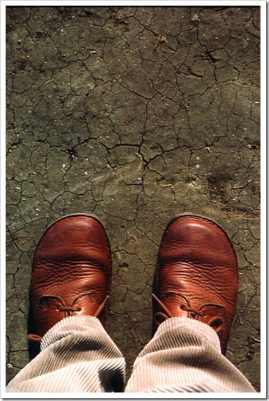 feet on parched earth