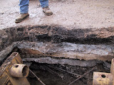 Layers of old street pavement in DT Houston 1.JPG