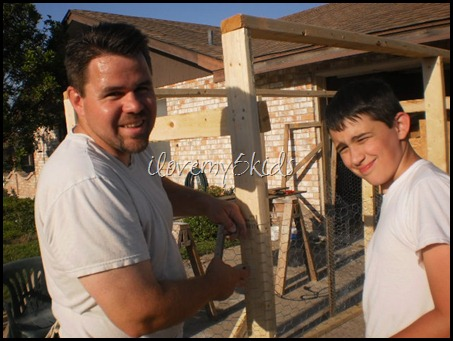 Father and Son Building Chicken Coop