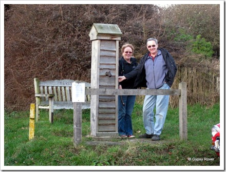Derek and Elizabeth at the village water pump in Kersey, Suffolk. The seat is a memorial to a couple named Kersey.