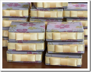 stacks of stamp club candle boxes