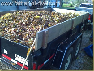 The other truck driving between the houses to pick up leaves.