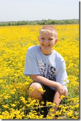 Zach in yellow flowers 2